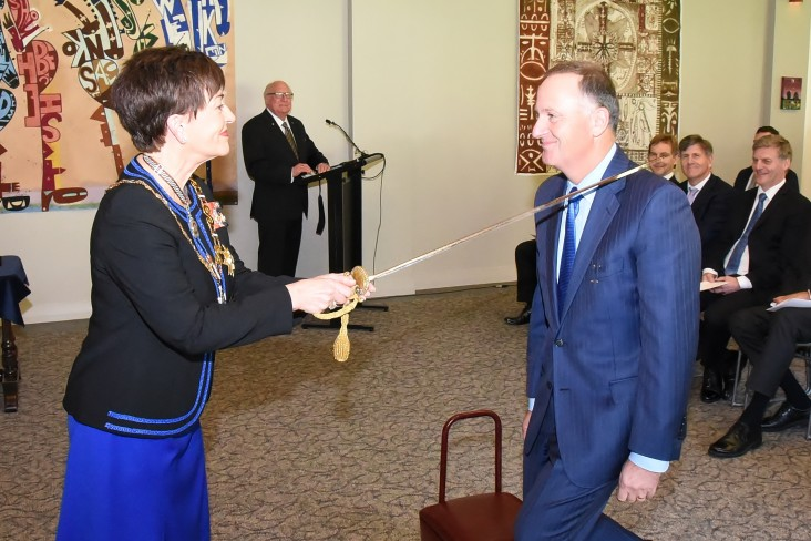 Image of John Key being made a Knight Grand Companion of the New Zealand Order of Merit