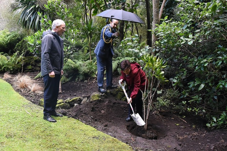 Image of Dame Patsy planting one of the trees
