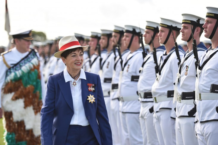an image of Dame Patsy inspecting Navy personnel