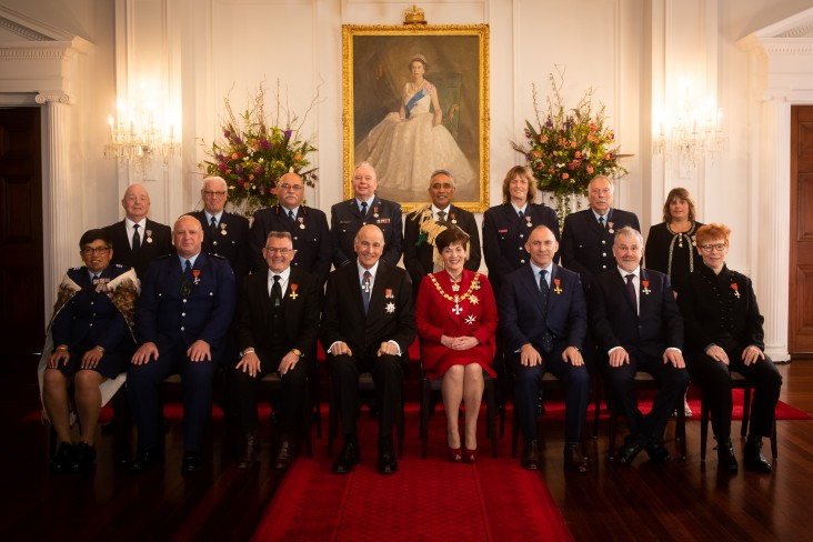 Their Excellencies with the 14 honours recipients