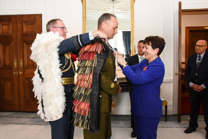Chief of Defence Air Marshall Kevin Short and Dame Patsy presenting the hieke to WO1 Mark Mortiboy