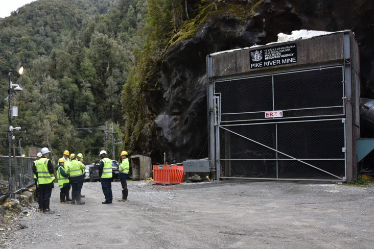 Image of Dame Patsy and party at the mine entrance