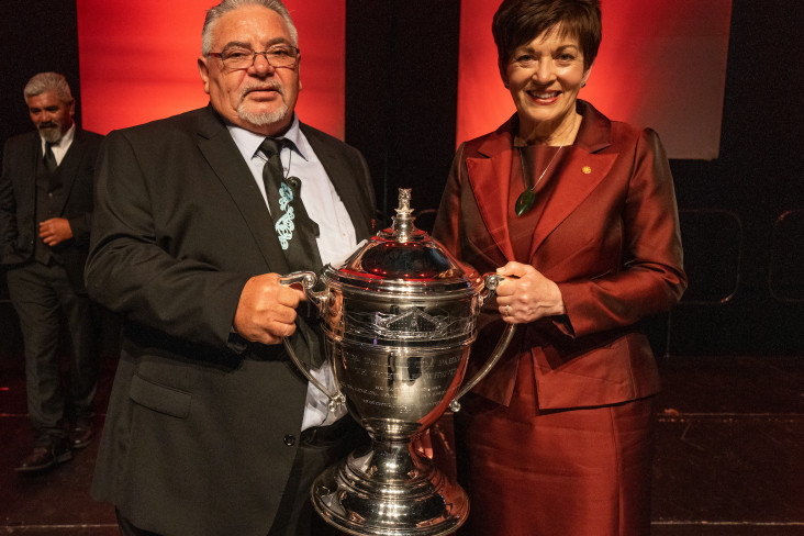 Dame Patsy presenting the Ahuwhenua Trophy to Norm Carter