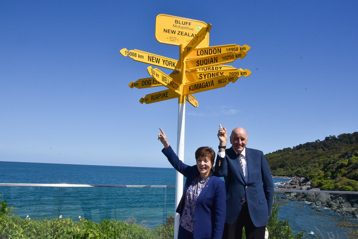 Dame Patsy and Sir David with Bluff's international signposts
