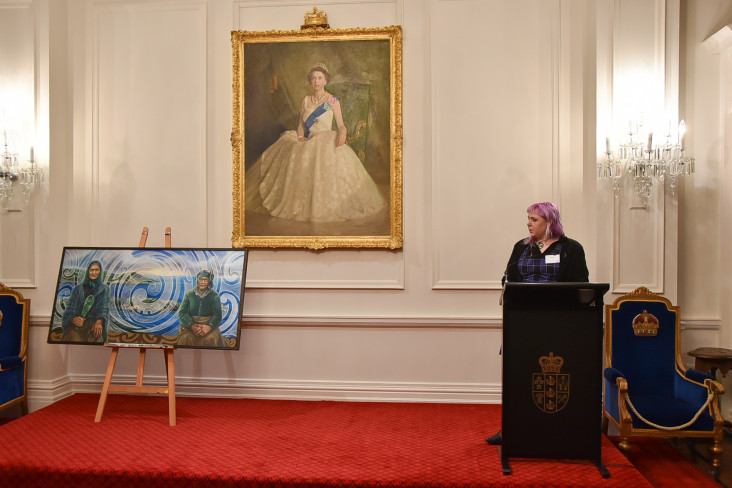 Image of Artist Izzy Joy talking about the symbolism of her painting