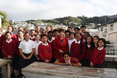 An image of Dame Patsy Reddy with students of St Anne's School