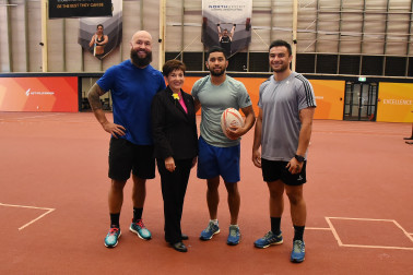 An image of Dame Patsy with NZ Sevens stars BJ Forbes, Rocky Khan and Sherwin Stower