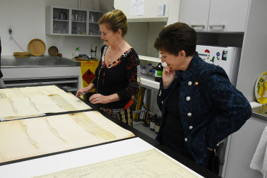 Image of Paper Conservator Camilla Baskcomb talking Dame Patsy through the conservation process for a collection of early 20th century architectural drawings