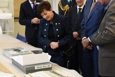 Image of Dame Patsy looking at papers from the Sir Peter Blake archive