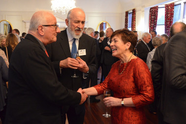 Image of Dame Patsy talking to guests at the reception