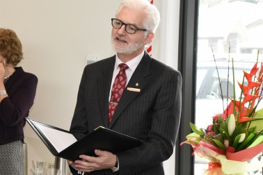 Image of Official Secretary Greg Baughen reading the citation