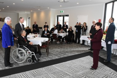 Image of Dame Patsy speaking at the special investiture for Hon Jim Anderton in Christchurch