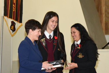 an image of Dame Patsy and students