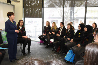 an image of Dame Patsy answering questions from senior students