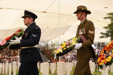 an image of wreaths from New Zealand and Australia at the Anzac Service