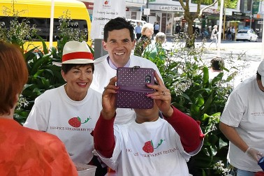 Image of festival volunteer Naina taking a selfie with Dame Patsy and Mayor Justin Lester