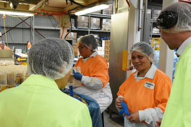 Dame Patsy chatting with factory staff