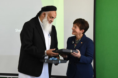 Image of  AMS Principal Mr Asin Ali gifting Dame Patsy with a plaque