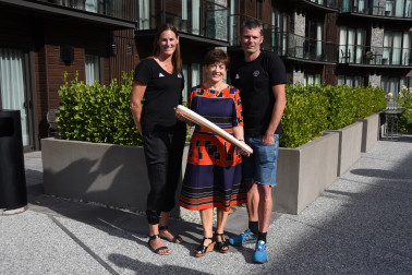 an image of Dame Patsy, Donna Wilkins and Matt Randall with the Queen's Baton