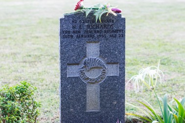 an image of One of the gravestones of the nine New Zealand defence personnel and dependents at Cheras
