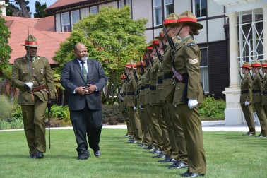an image of HE Mr Johnson Naviti inspecting the Honour Guard
