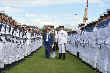 an image of Dame Patsy and navy personnel