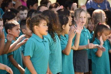 an image of Kaitaia Primary School students welcoming Dame Patsy and Sir David