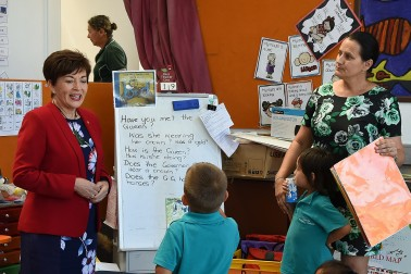 an image of Dame Patsy with new entrant children at Kaitaia Primary School