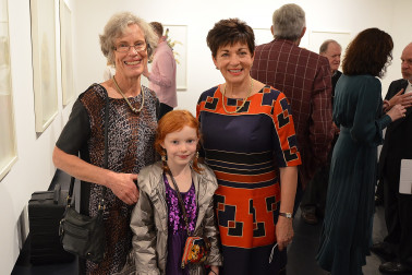 Image of a young girl meeting Dame Patsy