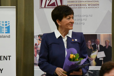 an image of Dame Patsy presented with Zonta's yellow roses
