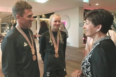 Image of Dame Patsy with Triathlon Mixed team bronze medallists Ryan Sisson and Nicole van der Kaay