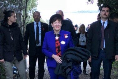 an image of Dame Patsy leaving the Anzac Dawn Service