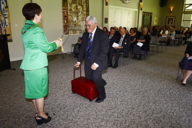 Image of Sir Bryan Williams, of Auckland, being knighted for services to rugby