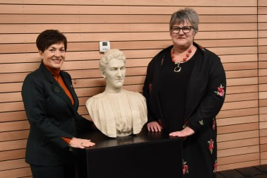 an image of Dame Patsy and Principal Pauline Duthie with a bust of the school's second principal, Helen Connon