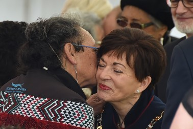Image of dame Patsy being kissed by a kuia on Putiki Marae