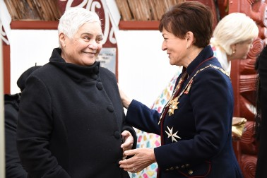 Image of Dame Patsy and Dame Tariana talking after the powhiri