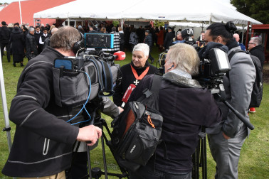 Image of Dame Tariana being interviewed by the media