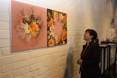 Image of Dame Patsy examining Kathryn Wightman's stunning powdered glass work
