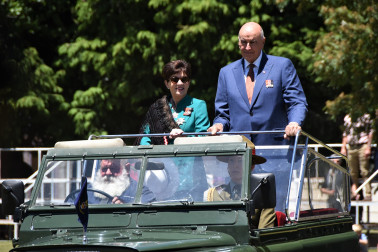 an image of Dame Patsy and Sir David arriving in the jeep used by HM Queen Elizabeth in 1953