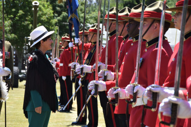 an image of Dame Patsy inspecting the officer cadets