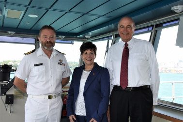 an image of Dame Patsy and Sir David with Commander Matt Wray of HMNZS Canterbury