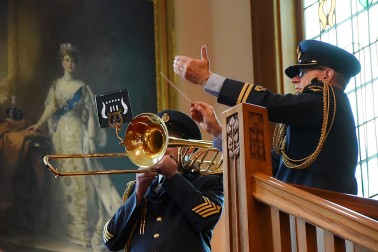 Image of the RNZAF band playing the Tongan national anthem
