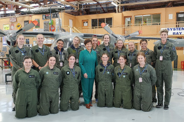 Image of Dame Patsy with students in the Logistics Training Squadron hangar