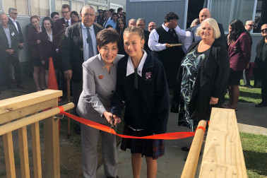 Image of Dame Patsy and Lakeisha Ngaika, the programme's youngest student, cutting the ribbon