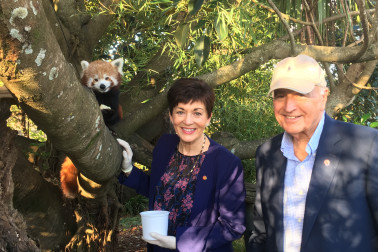 Image of Dame Patsy and Sir David with a red panda