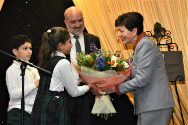 Dame Patsy receiving flowers at Iqra Elementary School