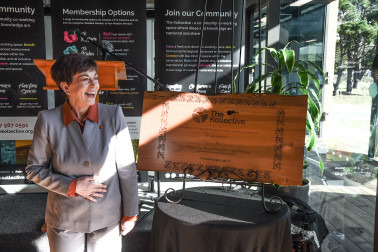 Image of Dame Patsy with the plaque