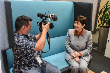 Dame Patsy being interviewed by local media