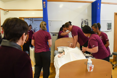 Image of nursing students showing what they've learned during their resuscitation training
