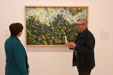 "Image of Dame Patsy looking at the McCahon painting ""Titirangi'"